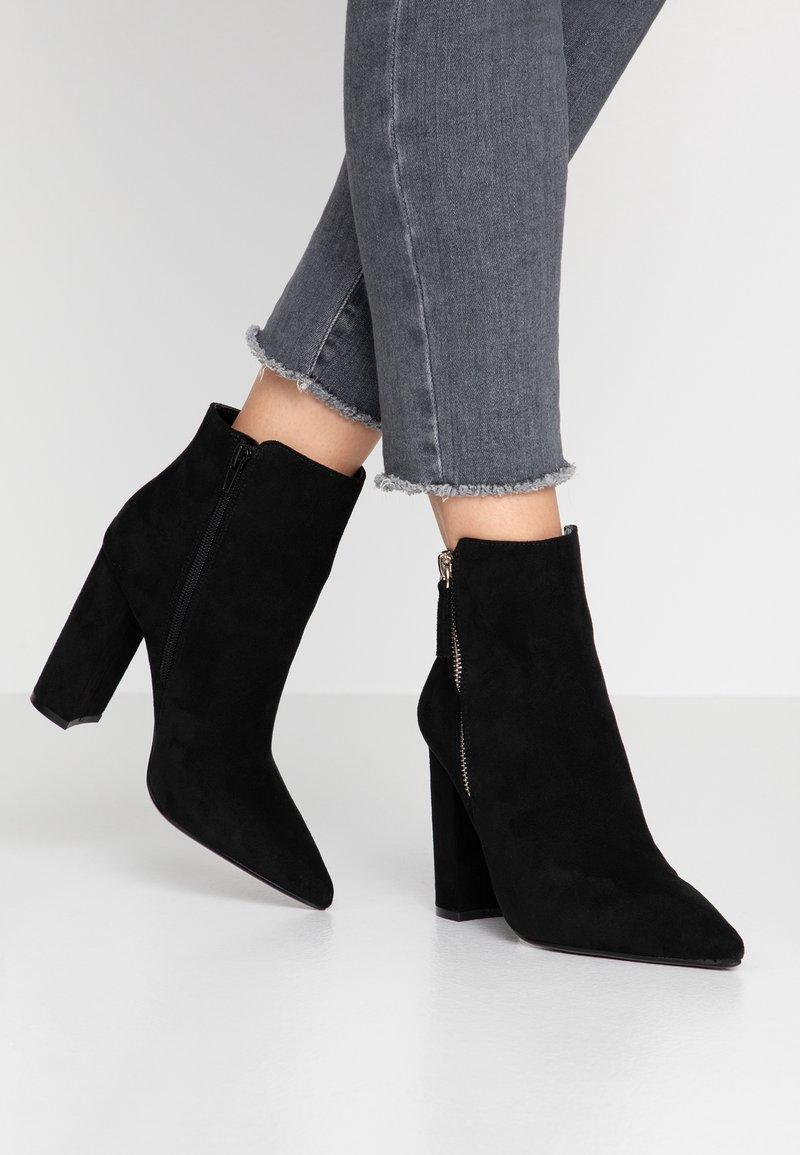 Buffalo - FERMIN - Kotníková obuv na vysokém podpatku - black