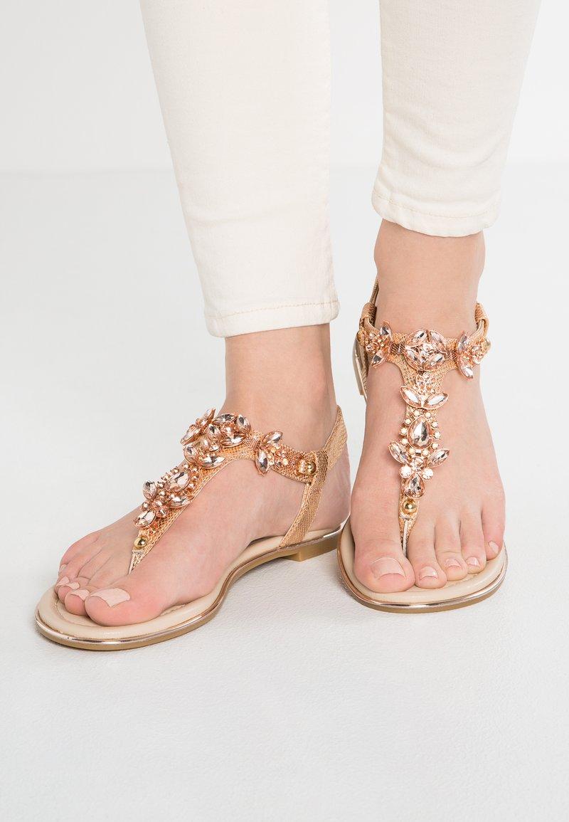 Buffalo - T-bar sandals - metallic/rose gold