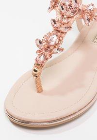 Buffalo - T-bar sandals - metallic/rose gold - 6
