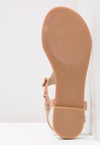 Buffalo - T-bar sandals - metallic/rose gold - 5