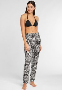 Buffalo - Trousers - black/cream - 1