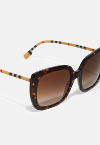 Burberry - Lunettes de soleil - mottled brown/gold-coloured