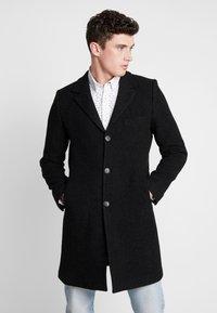 Brixtol Textiles - IAN - Mantel - black melange - 0