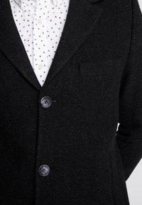 Brixtol Textiles - IAN - Mantel - black melange - 5