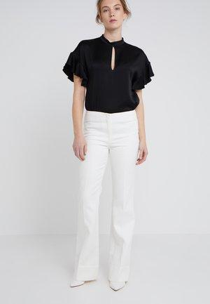 Spodnie materiałowe - soft white/creme