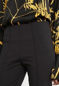 By Malene Birger - ADELIO - Trousers - black - 5