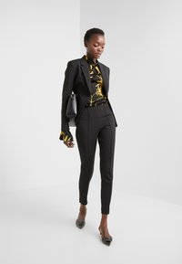 By Malene Birger - ADELIO - Trousers - black - 1