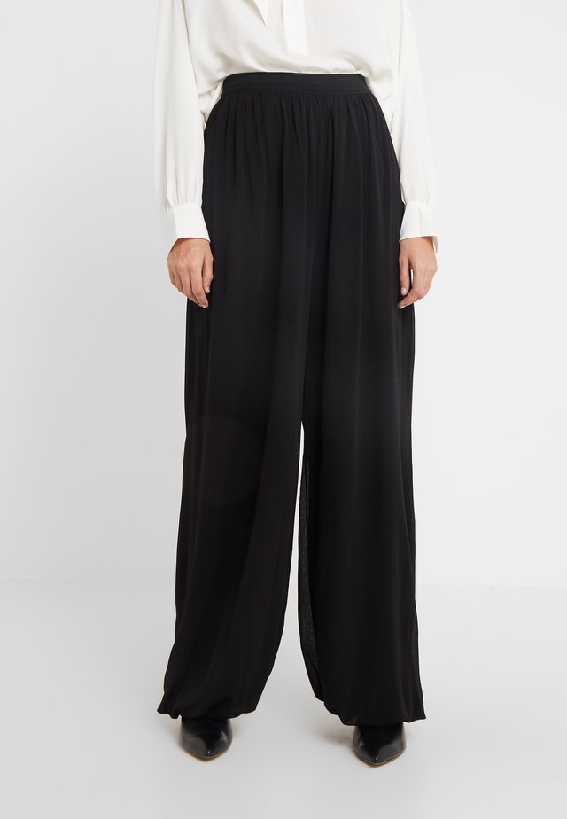 ASTELIA - Trousers - black