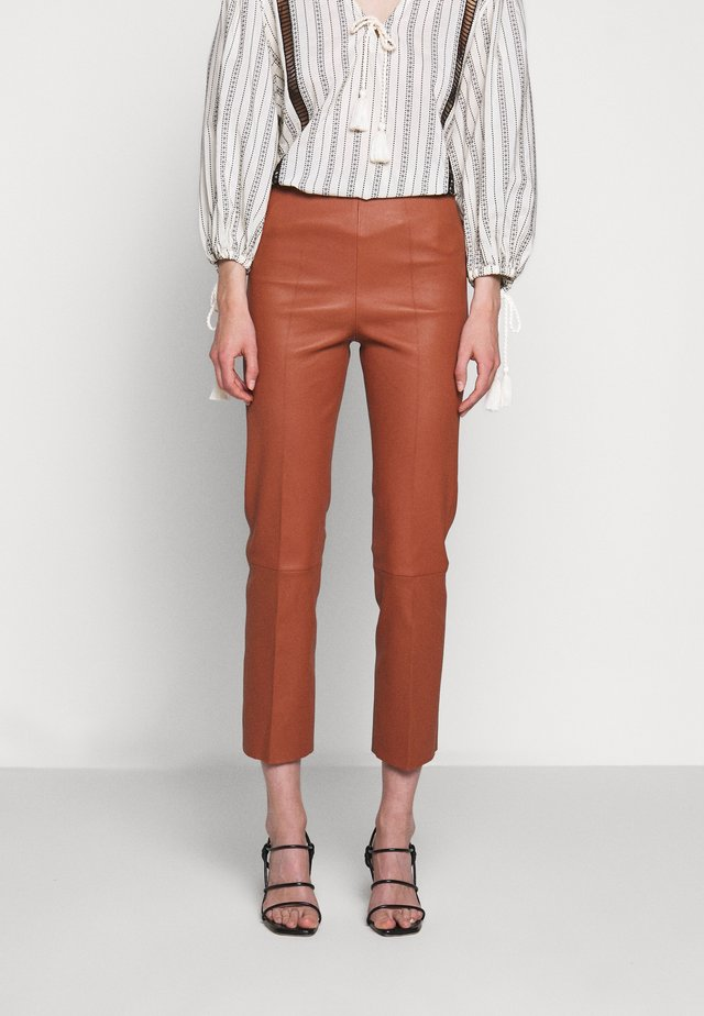 FLORENTINA - Leather trousers - brick