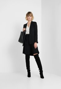 By Malene Birger - LEELA - Gonna a campana - black - 1