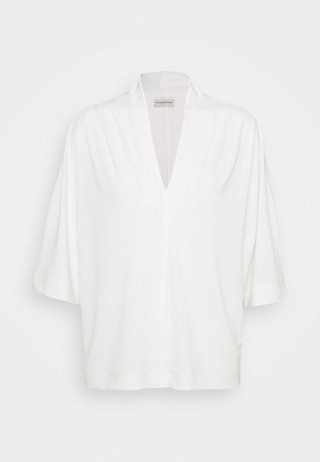 BIJANA - Basic T-shirt - soft white