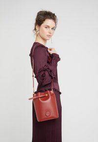 By Malene Birger - Across body bag - red clay - 1