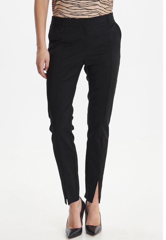 BYDENIA  - Trousers - black