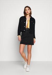 b.young - BYKIRI SKIRT - Denim skirt - faded black denim - 1
