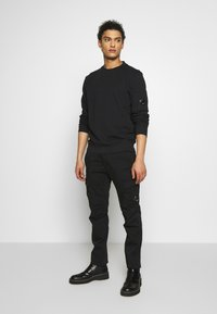 C.P. Company - Cargo trousers - black - 1