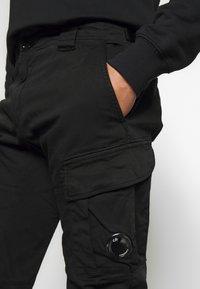 C.P. Company - Cargo trousers - black - 5