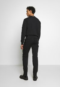 C.P. Company - Cargo trousers - black - 2
