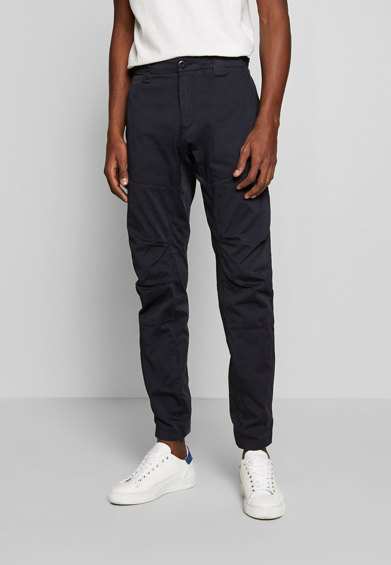 C.P. Company - TROUSERS - Trousers - navy