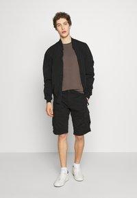 C.P. Company - BERMUDA - Shorts - black - 1