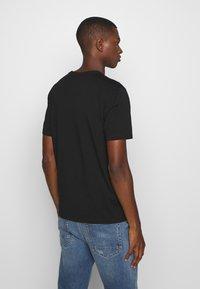 C.P. Company - LOGO - T-shirt print - black - 2