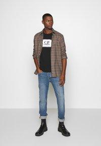 C.P. Company - LOGO - T-shirt print - black - 1