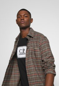 C.P. Company - LOGO - T-shirt print - black - 3