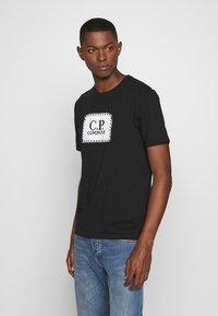 C.P. Company - LOGO - T-shirt print - black - 0