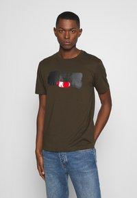 C.P. Company - LOGO T-SHIRT - Print T-shirt - green - 0