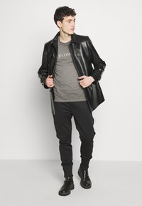 C.P. Company - Print T-shirt - black - 1