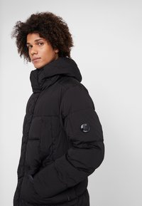 C.P. Company - LONG PUFFER - Down jacket - black - 5