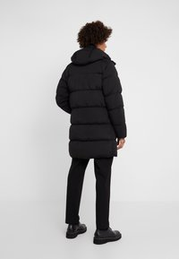 C.P. Company - LONG PUFFER - Down jacket - black - 2