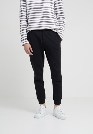 ARTICULATED SEAM PANT - Pantalon de survêtement - black