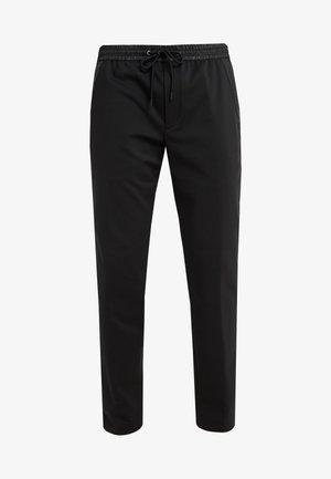 TRAVEL PANT - Spodnie materiałowe - black