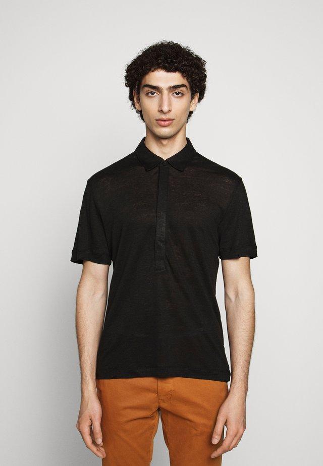POPOVER - Polo shirt - black