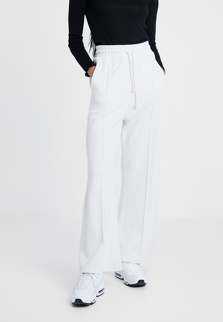 Champion Reverse Weave - WIDE LEG TROUSERS - Träningsbyxor - white