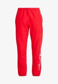 Champion Reverse Weave - BIG SCRIPT CUFF PANTS - Pantalon de survêtement - red - 4