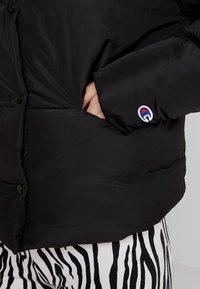 Champion Reverse Weave - BACK SCRIPT PUFF JACKET - Zimní bunda - black - 5