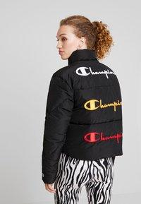 Champion Reverse Weave - BACK SCRIPT PUFF JACKET - Zimní bunda - black - 2