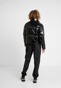 Champion Reverse Weave - PUFF JACKET - Vinterjakke - black - 2