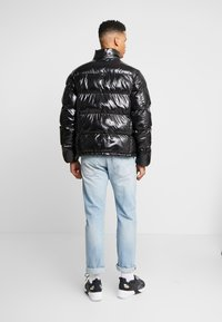 Champion Reverse Weave - HOODED PUFF JACKET - Zimní bunda - black - 3