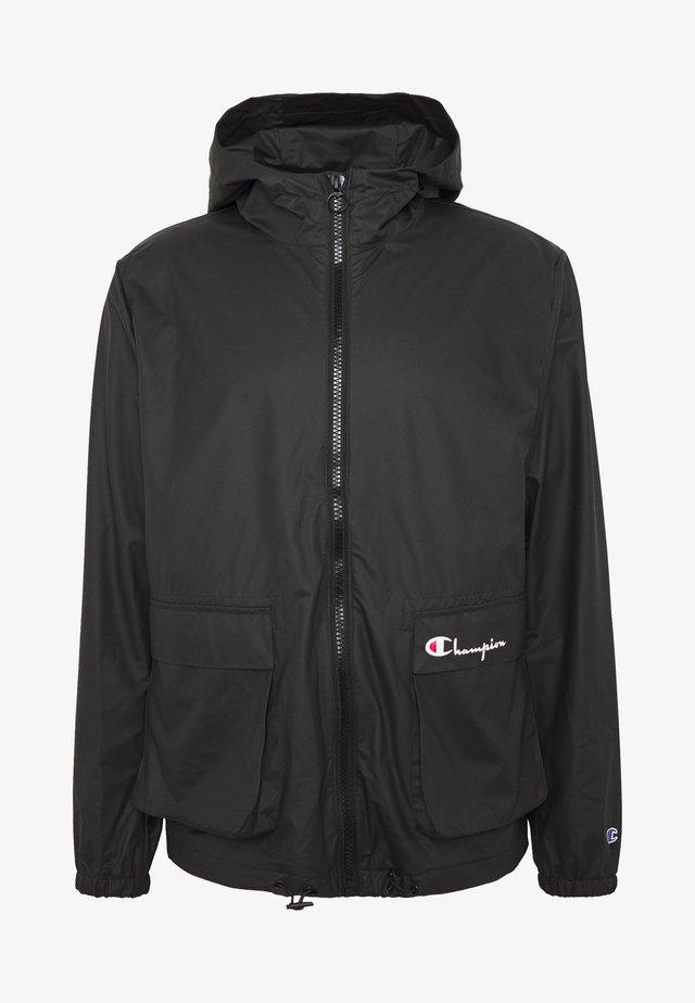 JACKET - Waterproof jacket - black