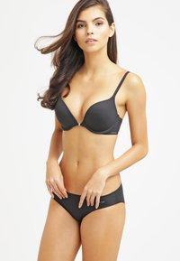 Calvin Klein Underwear - PERFECTLY FIT - Push-up bra - black - 1