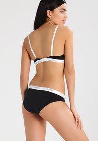 Calvin Klein Underwear - CHEEKINI - Alushousut - black - 2
