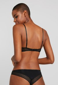 Calvin Klein Underwear - FLIRTY UNLINED - Triangel BH - black - 2