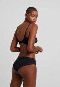 Calvin Klein Underwear - PETAL UNLINED PLUNGE - Triangel-BH - black - 2