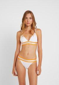 Calvin Klein Underwear - HAZARD UNLINED - Bikini top - white - 1