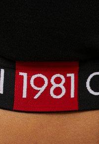 Calvin Klein Underwear - BOLD 1981 PLUS SIZE UNLINED BRALETTE - Topp - black - 5