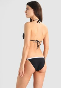 Calvin Klein Swimwear - NOS LOGO STRING SIDE TIE - Bikinibroekje - black - 2