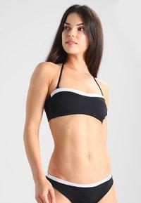 Calvin Klein Swimwear - NOS LOGO BANDEAU-RP - Bikinitoppe - black - 0