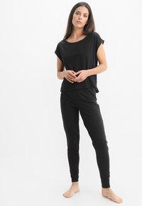 Calvin Klein Underwear - JOGGER - Nattøj bukser - black - 1